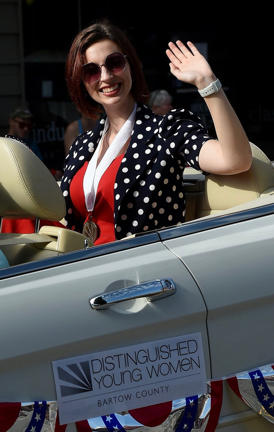 "Distinguished Young Woman of Bartow County Abigail ""Abby"" Matthews waves to the crowd during the WBHF and Rotary Club of Etowah Fourth of July Parade in downtown Cartersville."