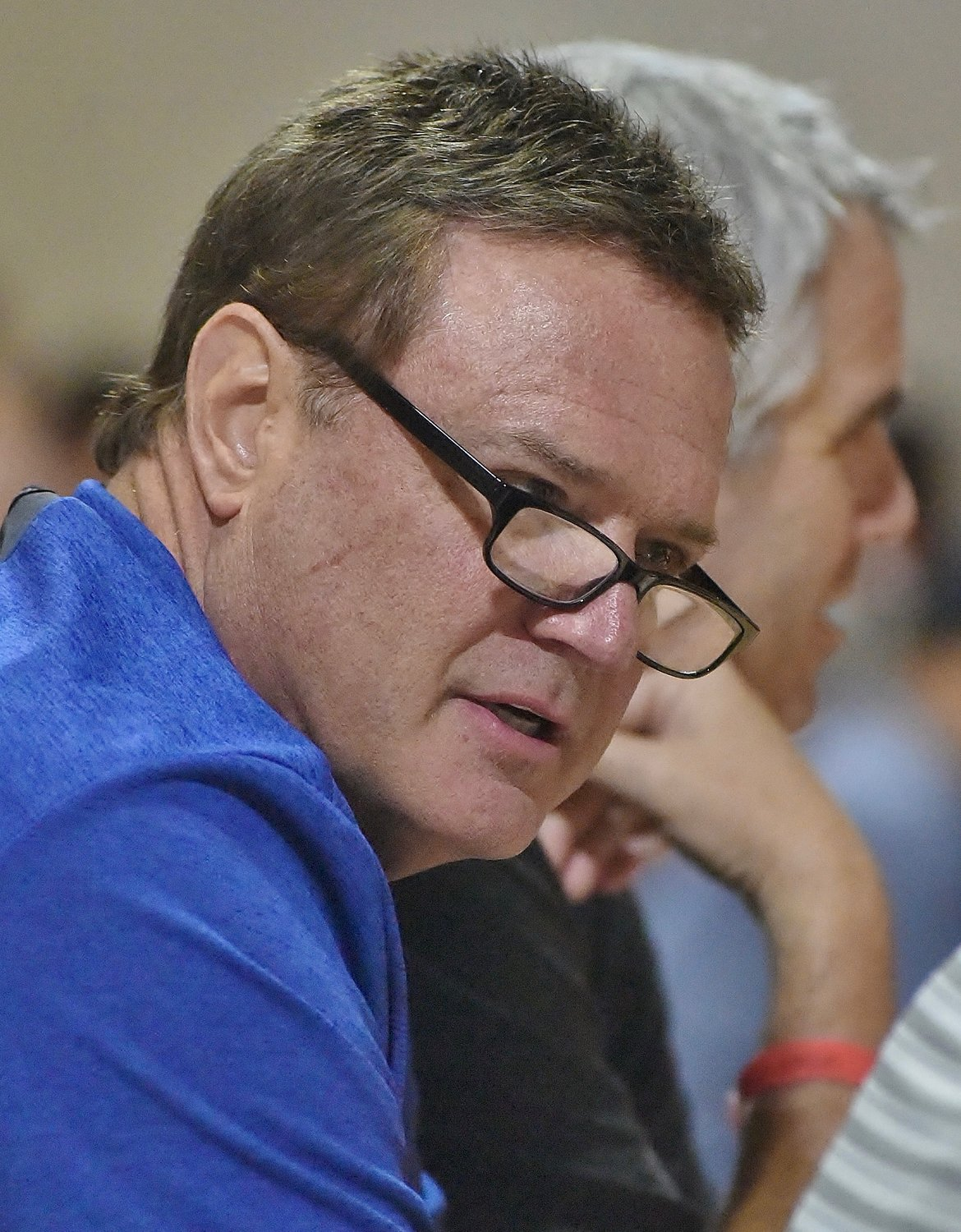 Kansas men's basketball coach Bill Self speaks with a colleague during the UAA FInals Thursday at LakePoint.