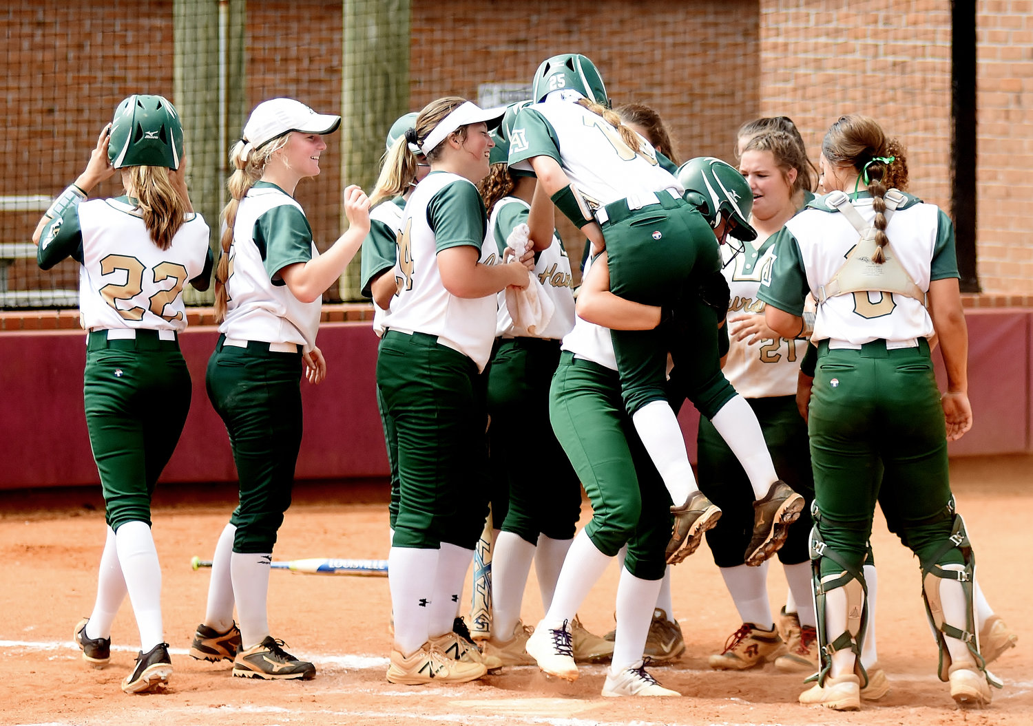 The Adairsville softball team celebrates Breeana Wilson's home run in the Bartow County Championships by lifting her in the air in the tournament's third-place game on Sept. 1, 2018. Wilson and four other players graduated off last year's team, but the Tigers still return plenty of talent in 2019.