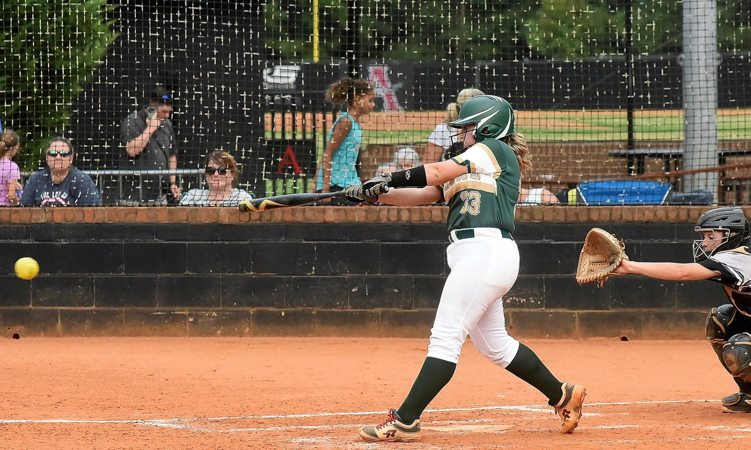 Adairsville junior Victoria O'Neal sends an RBI single through the infield to score the Tigers' third and final run in Wednesday's 11-3 road loss to Allatoona.