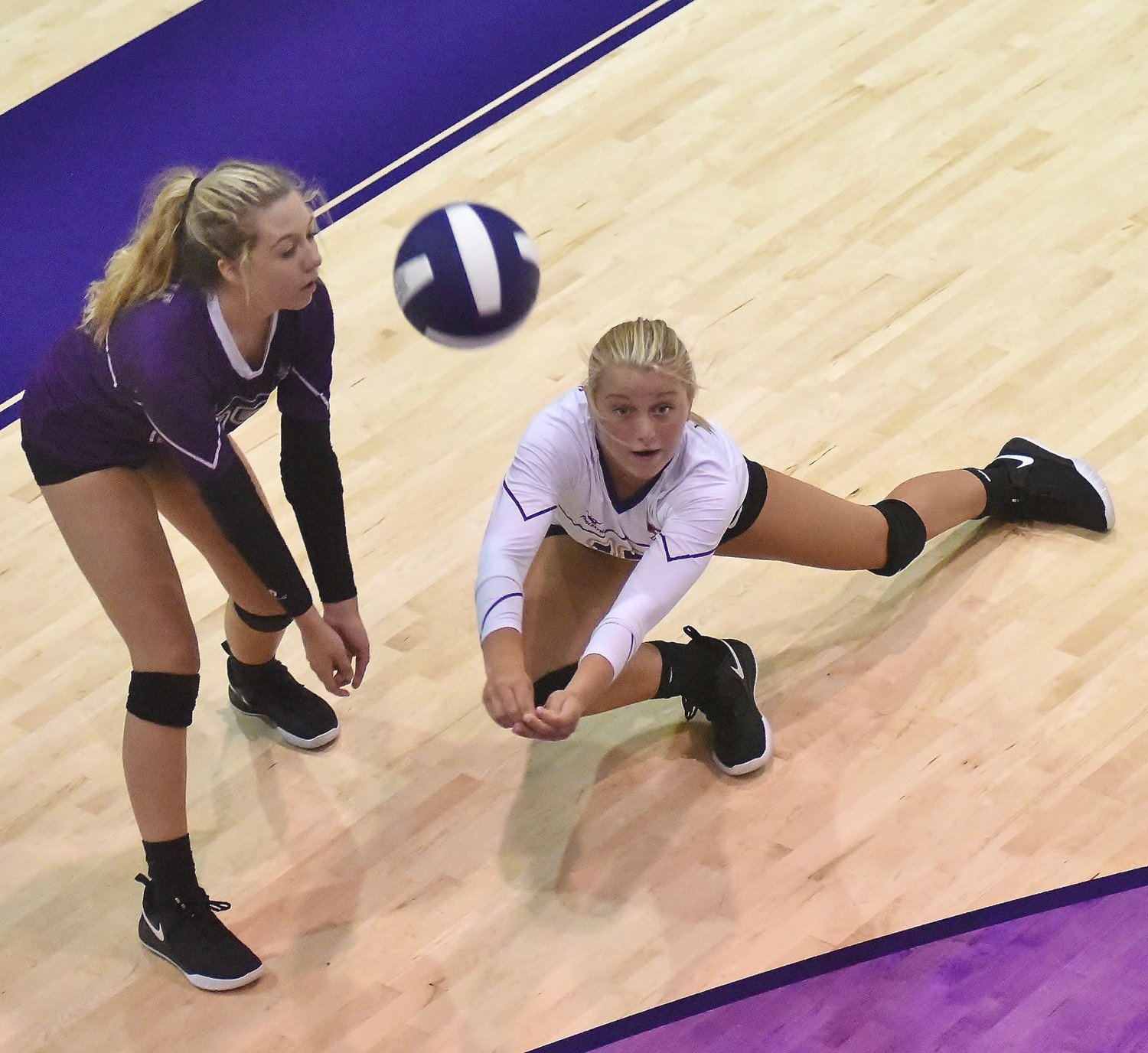 Anna Mathis, left, digs the ball ahead of Anna Grace Brock during a 2018 Cartersville volleyball match. Mathis and several seniors from last year's state semifinalist team have graduated, but Brock and plenty of young players are preparing to keep the Canes among the best programs in Class 4A.
