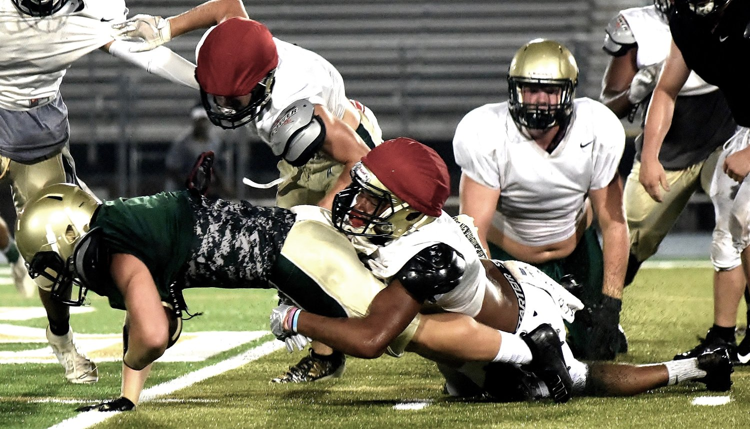 Adairsville football players swarm to the ball to make a tackle during a practice on Aug. 1. Adairsville hosts Woodland in a preseason scrimmage at 7:30 p.m. Friday.