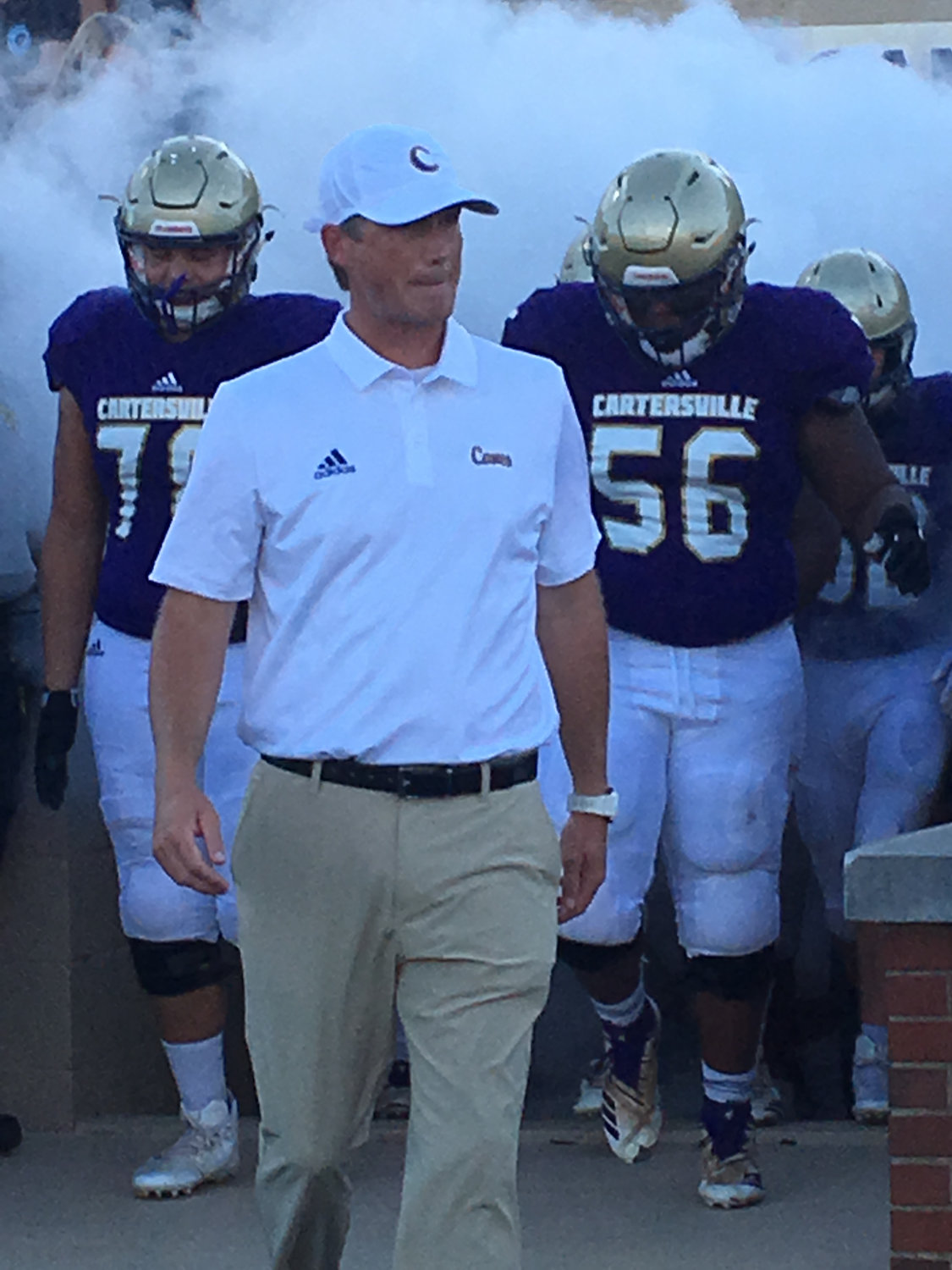 Cartersville first-year head football coach Conor Foster comes out of Hurricane Alley before Friday's scrimmage against Dalton at Weinman Stadium.