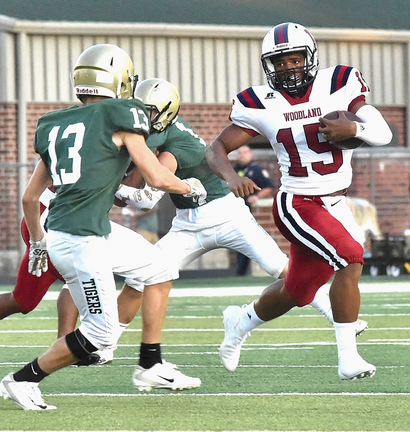 Woodland quarterback J.T. Thomas carries the ball as Adairsville's Doss Dudley defends during Friday's scrimmage at Tiger Stadium.