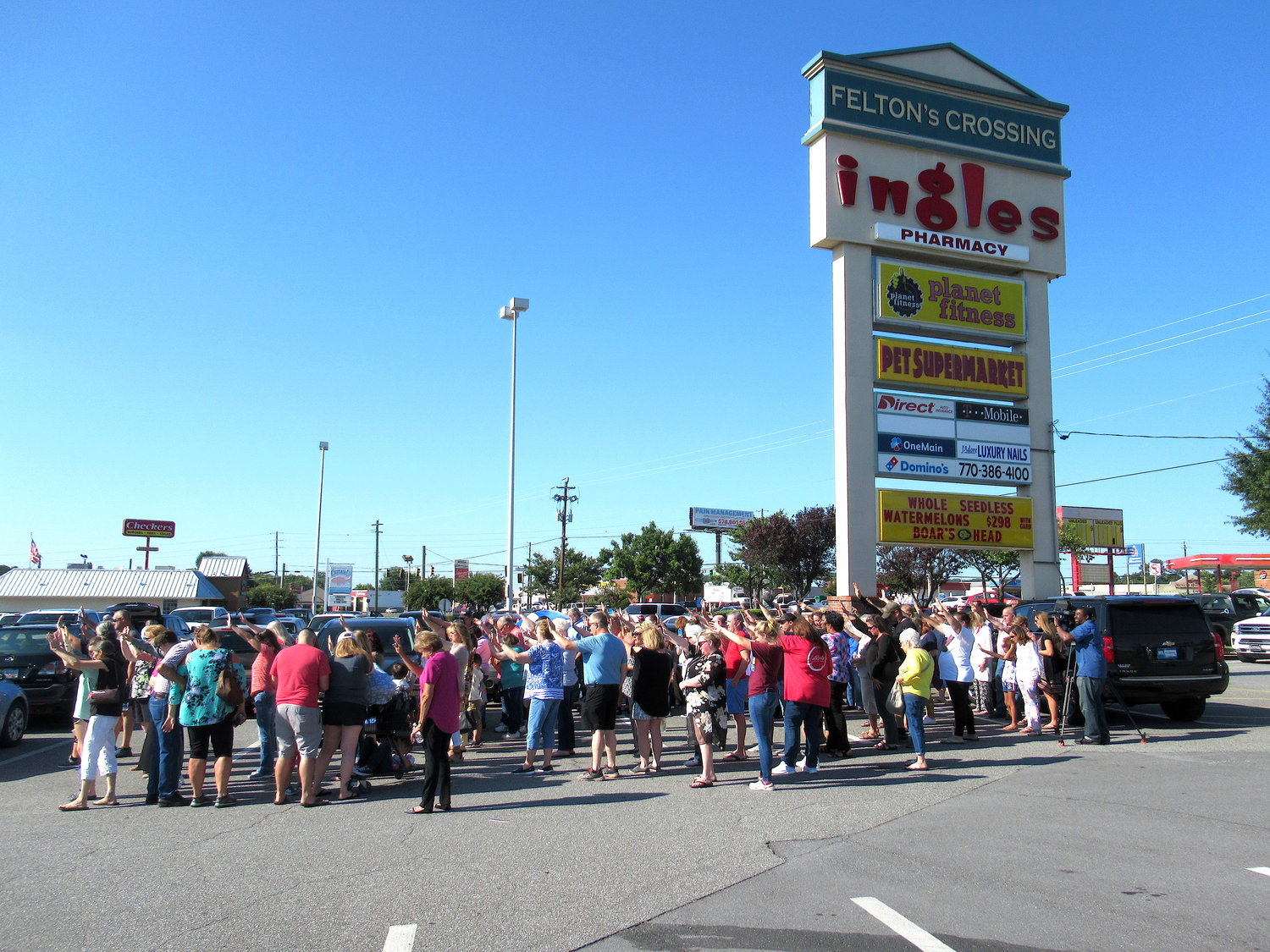A large crowd turned out Wednesday afternoon to rally behind an Ingles employee allegedly asked to refrain from praying for customers.