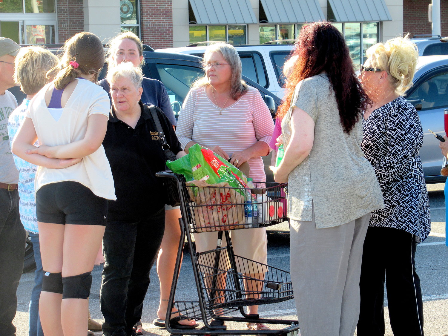 Ingles employee Barbara Crowe is greeted by supporters Wednesday afternoon.