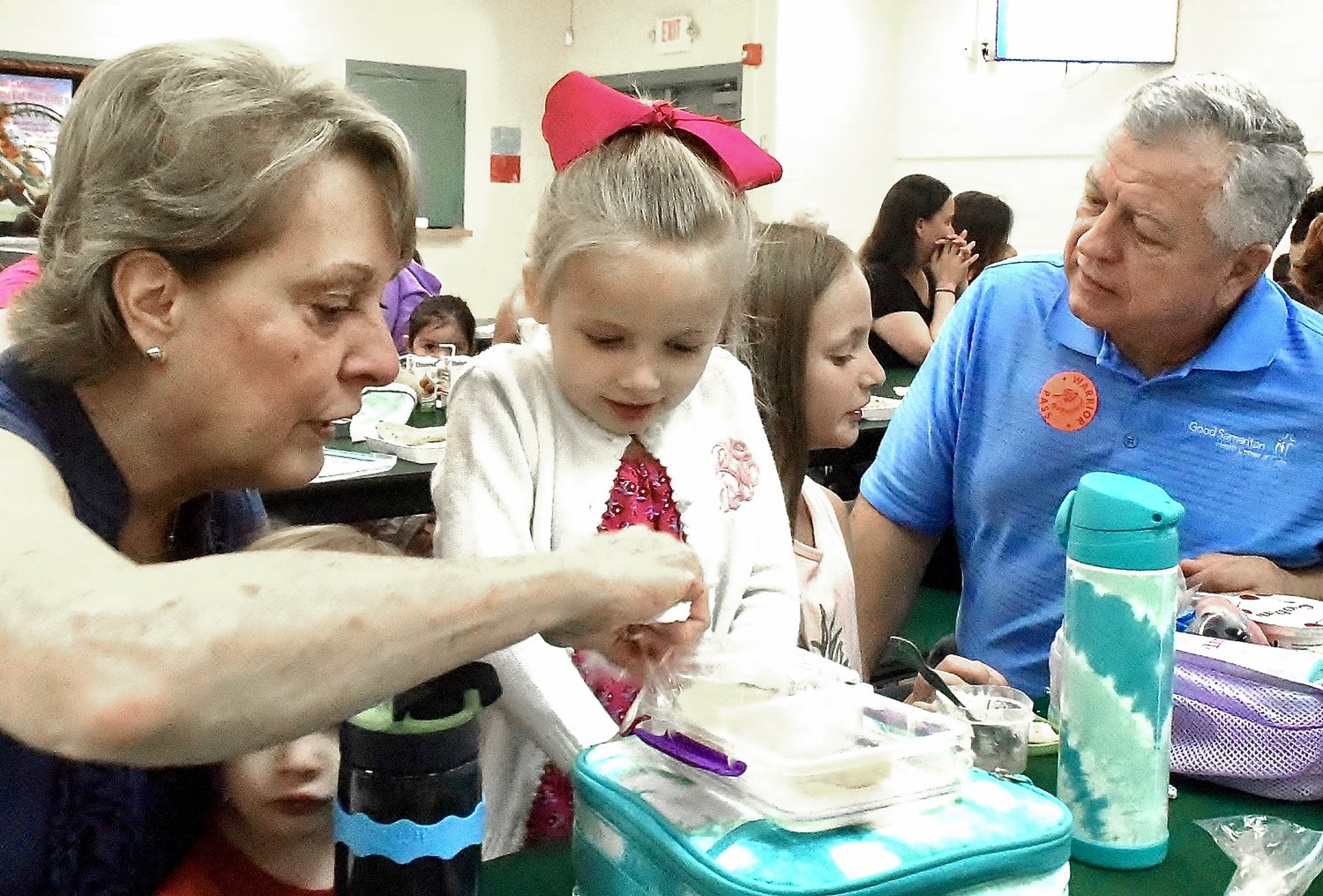 In recognition of today being Grandparents Day, Marjorie and Jerry Cox of Woodstock joined their granddaughters, Ansley Blanton, left center, a kindergartner, and Arlington Blanton, a third-grader, for lunch Friday at White Elementary School.