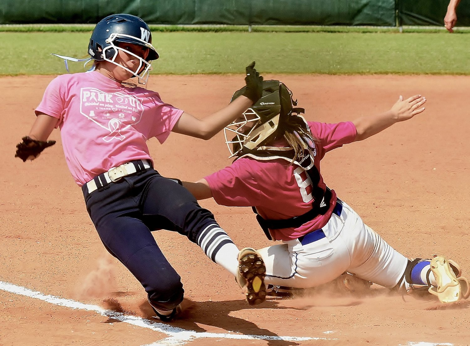 Cass sophomore catcher Saydee Najarro tags out Woodland senior Bella Carnes, as Carnes attempted to score on a flyball by Kendyl Hardin to left fielder Kelly Young in the championship game of the Bartow County tournament.