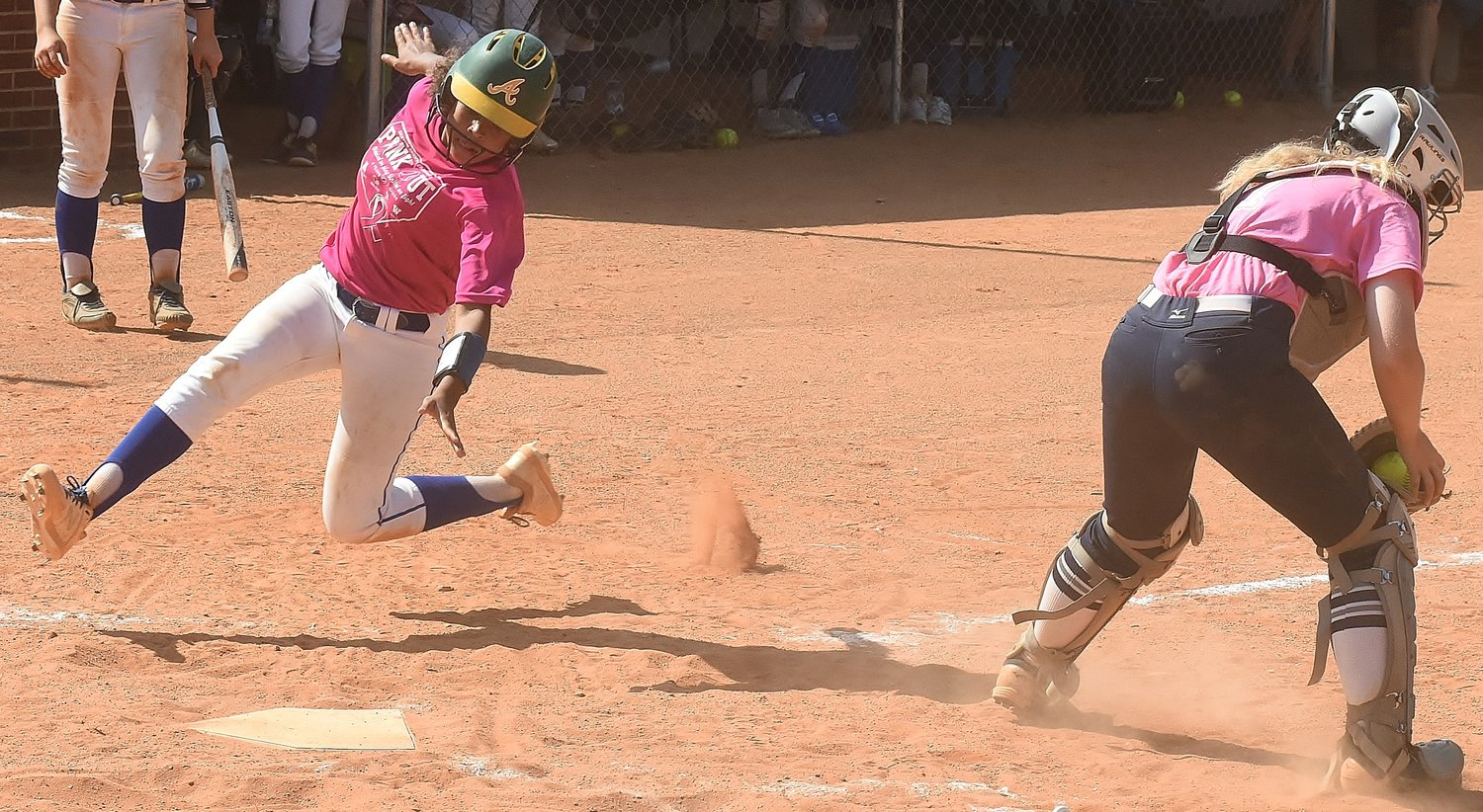 Cass freshman Alexis Woods scores ahead of a throw to Woodland senior catcher Allyssa Motes during Saturday's game at Adairsville Middle School.