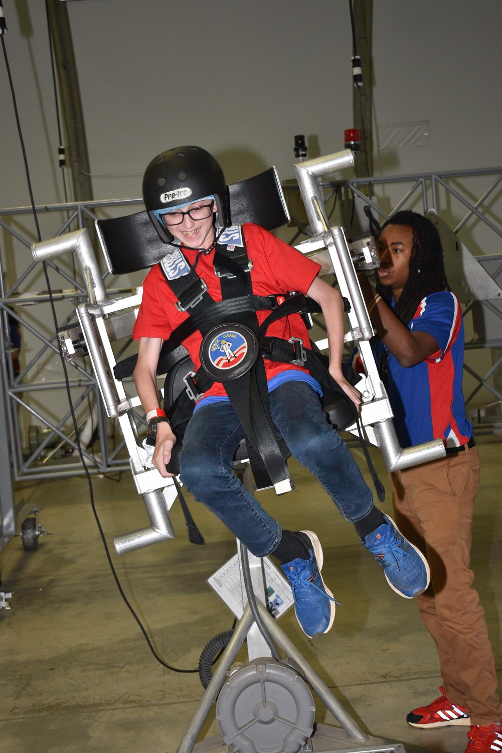 Evan Jeanneret, a seventh-grader at Cartersville Middle School, tries out the spacewalk simulator at Space Camp in July.