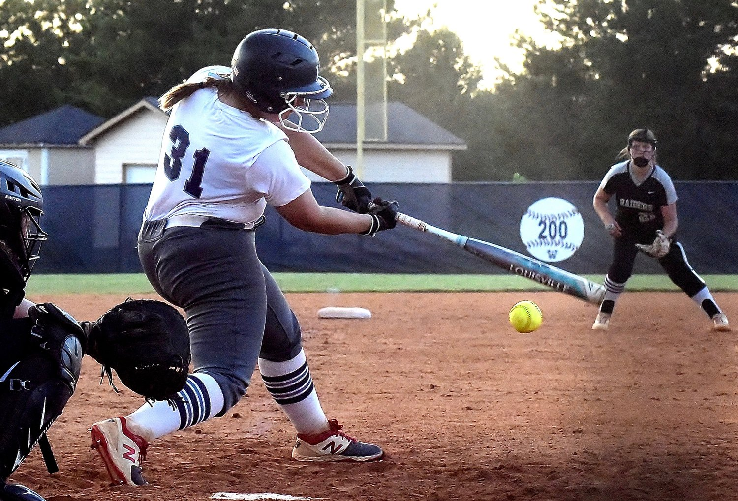 Woodland's Kendyl Hardin pulls a two-run double down the third base line in the fifth inning during Monday's home game against East Paulding. Hardin finished 1-for-3 with a walk and two RBIs in a 5-3 loss.
