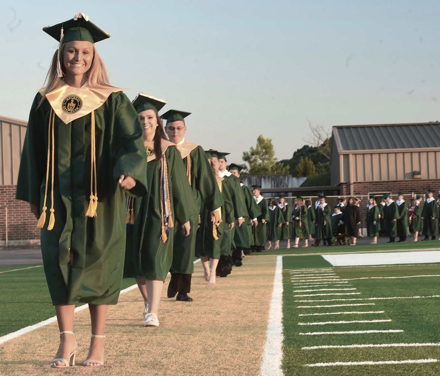 Adairsville 2019 graduate Havyn Isaac leads her classmates into Tiger Stadium for the ceremony on May 24.