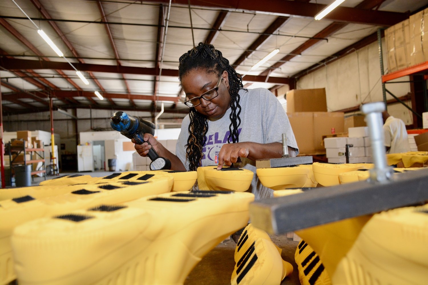 Marquita McCarver assembles Stripping Boots for Americo Manufacturing.