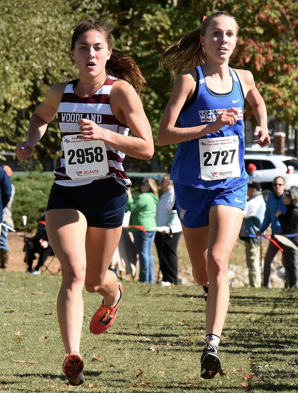 Woodland senior McKenna Trapheagen runs at the front of the pack with Veterans runner Mackenzie Walls during the Class 5A state championship meet Friday in Carrollton. Trapheagen separated from Walls in the second half of the race to win her second consecutive individual state title.