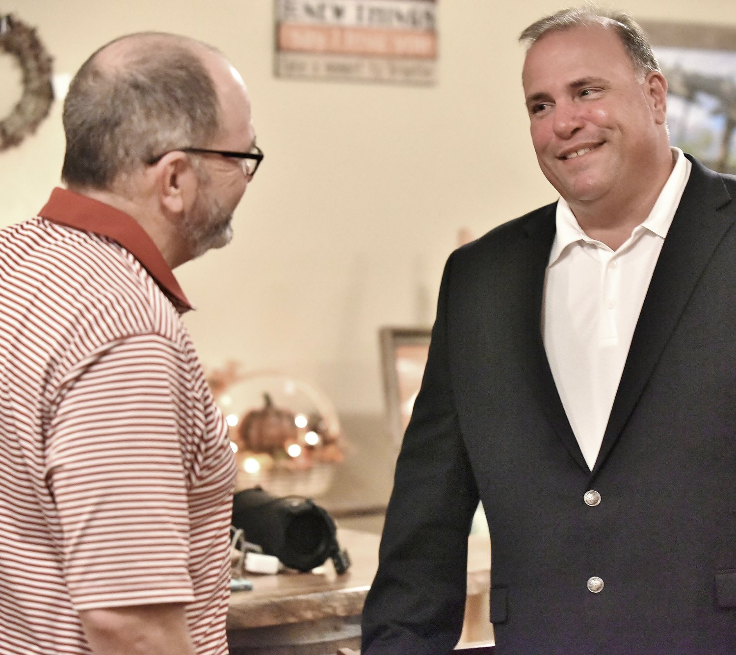Cartersville Mayor Matt Santini, right, speaks with former Cartersville Mayor Mike Fields at Santini's victory celebration Tuesday night at JZ's in downtown Cartersville.