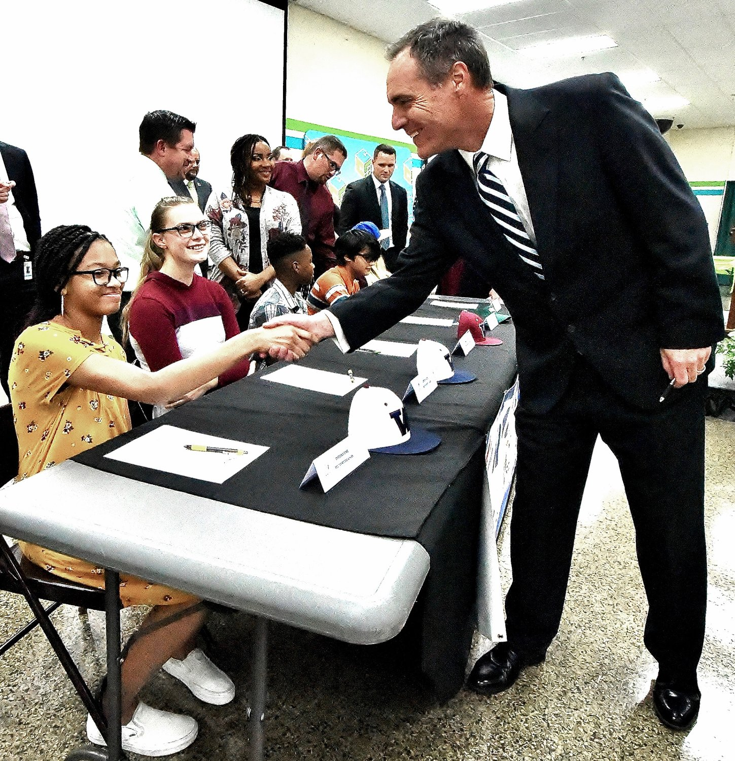 Bartow County School System Superintendent Dr. Phillip Page congratulates Red Top Middle School eighth grader Tyreana Sims after she signed her REACH Scholarship contract Thursday at the REACH Scholarship signing ceremony at the Bartow County College & Career Academy.