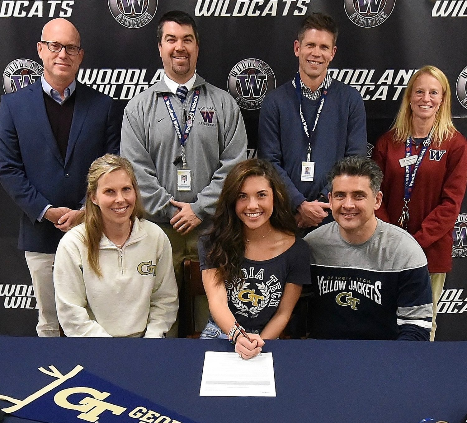 Woodland High senior McKenna Trapheagen signed to run cross country, indoor track and outdoor track at Georgia Tech. On hand for the signing were, from left, front row: Sheri Trapheagen, mother; and Alec Trapheagen, father; back row: Rob Forbes, WHS cross country coach; John Howard, WHS athletic director: David Stephenson, WHS principal; and Catherine Bollwerk, WHS cross country coach.