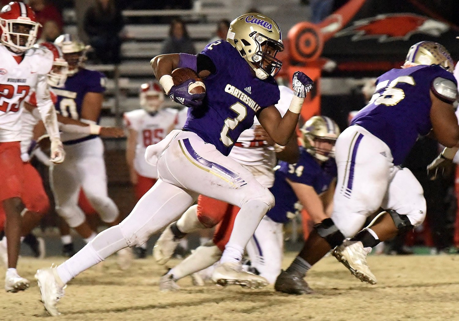 Cartersville junior running back Quante Jennings heads upfield during Friday's game at Weinman Stadium. Jennings is one of several underclassmen, along with blockers Hayden Cagle (54) and Devin Luckett (56), set to return for the Canes next season.