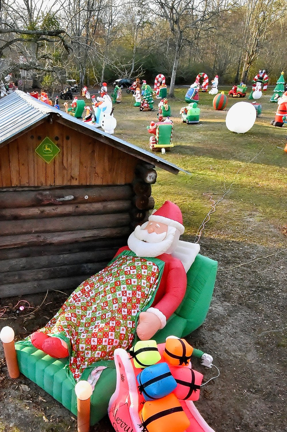 A large snoozing Santa is among the more than 300 inflatables on the front lawn of the home of Jerry and Sheila McGuirt.