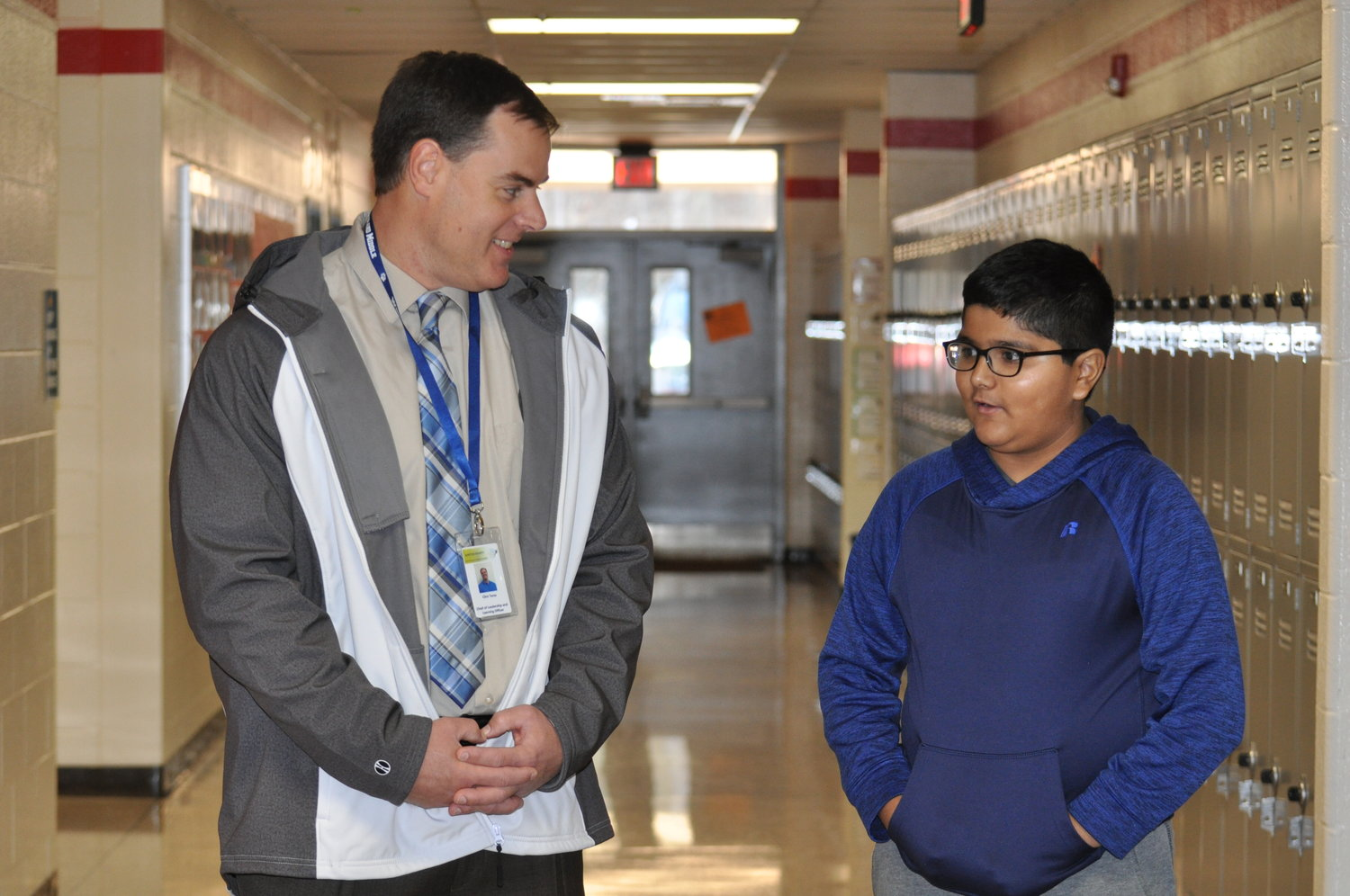 Chief Leadership and Learning Officer Clint Terza visited Red Top Middle sixth-grader Rudra Parmar Wednesday to congratulate him for his quick-thinking in summoning help when Ethan Hamrick was choking.