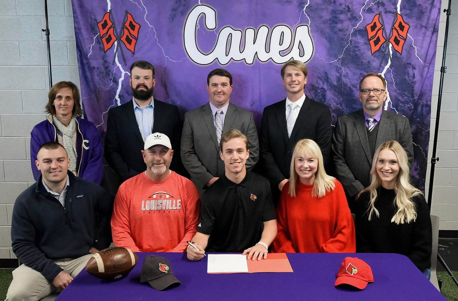 Cartersville High School senior Tee Webb signed Wednesday to play football at the University of Louisville. On hand for the signing were, from left, front row, Gabe Freeman, brother-in-law; Tracy Webb, father; Marion Webb, mother; and Haley Freeman, sister; back row, Shelley Tierce, CHS principal; Dusty Phillips, assistant CHS football coach; Michael Bail, CHS assistant football coach; Conor Foster, CHS head football coach; and Darrell Demastus, CHS athletic director.