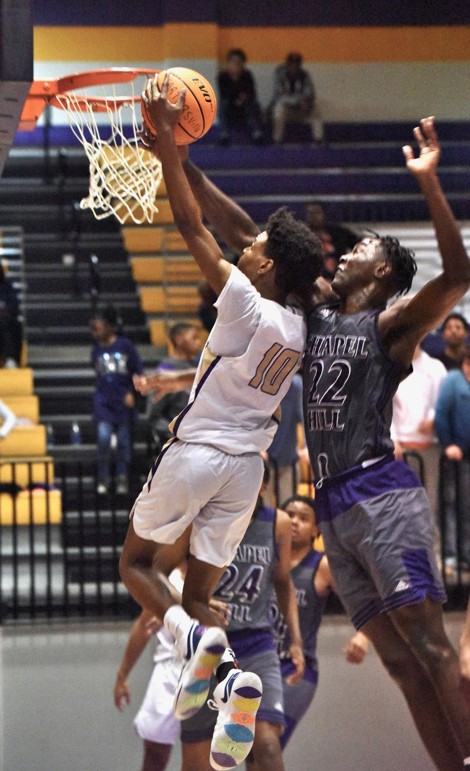 Cartersville senior Micah Tart goes up for a contested layup against Chapel Hill during Saturday's game at The Storm Center. Tart had 16 points in an 82-79 double-overtime loss.