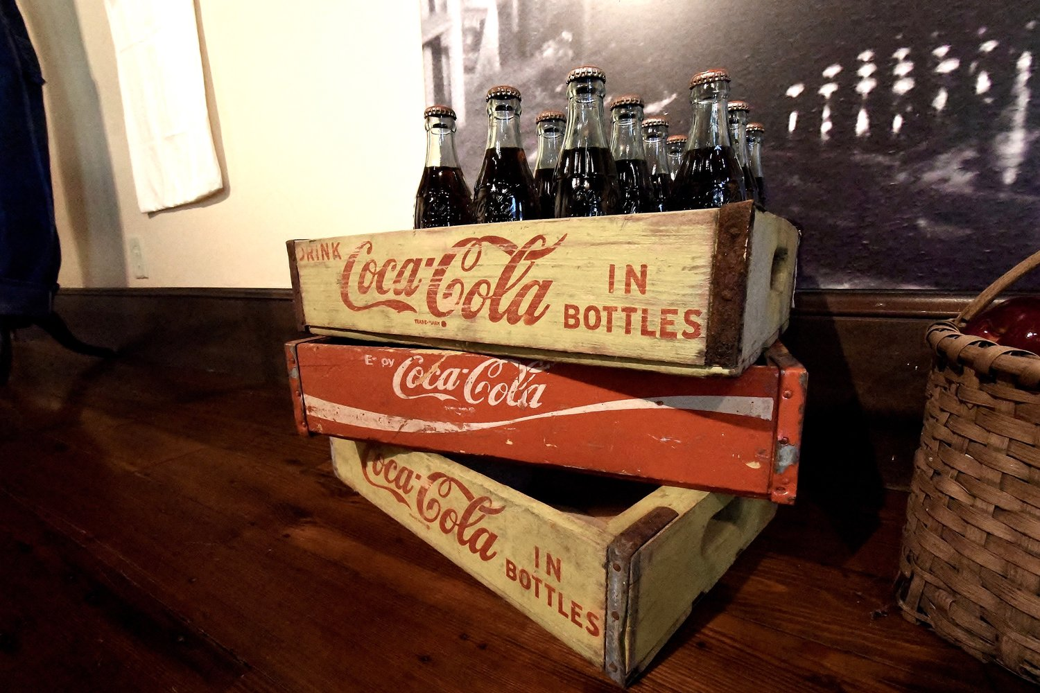 Coca-Cola crates and bottles serve as a reminder that the 1869 Courthouse was once the site of several grocery stores.