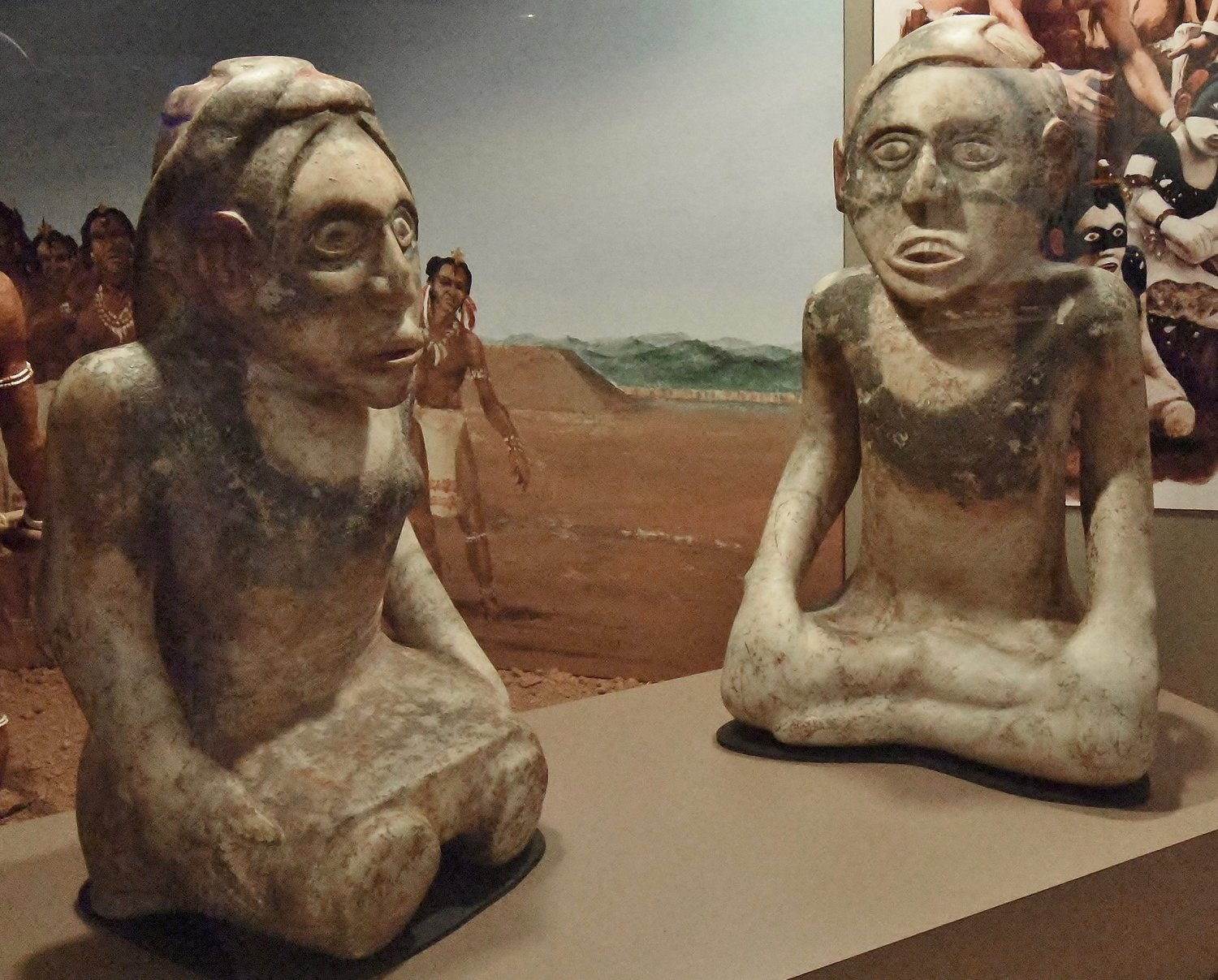 Two hand-carved effigies are displayed in the Etowah Indian Mounds' museum.