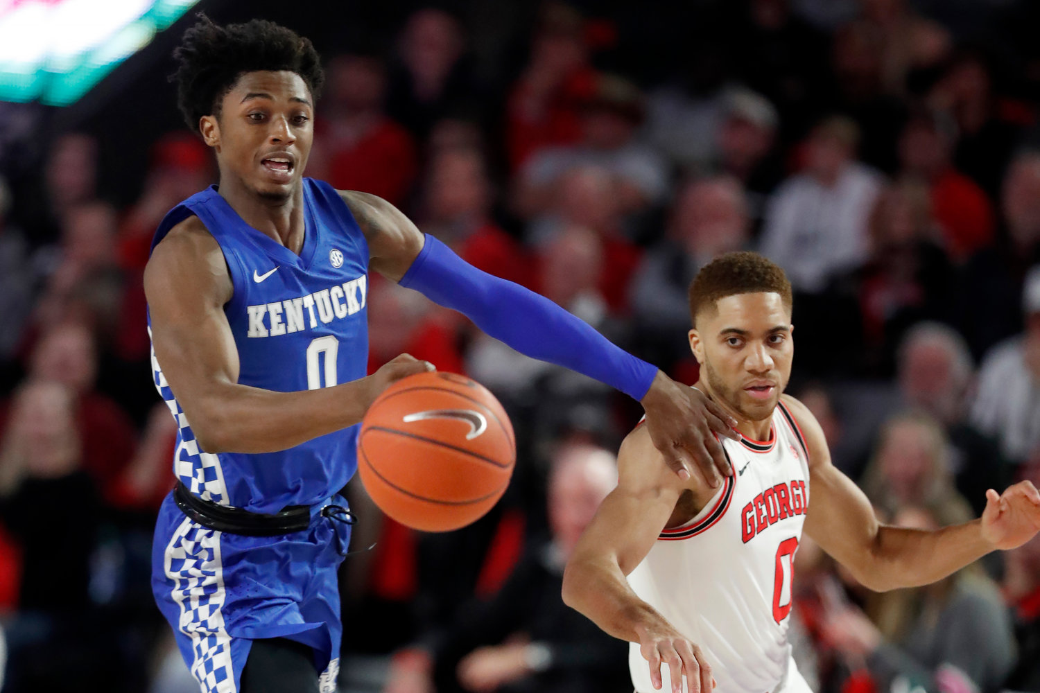 Kentucky guard Ashton Hagans and Georgia guard Donnell Gresham Jr. chase down a loose ball in the first half of a game Jan. 7 in Athens.