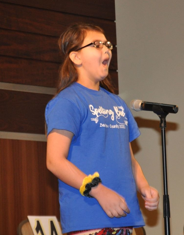 Kingston fifth-grader Leilah Bedford reacts to being named the winner of the 60th annual Bartow County Spelling Bee Friday.