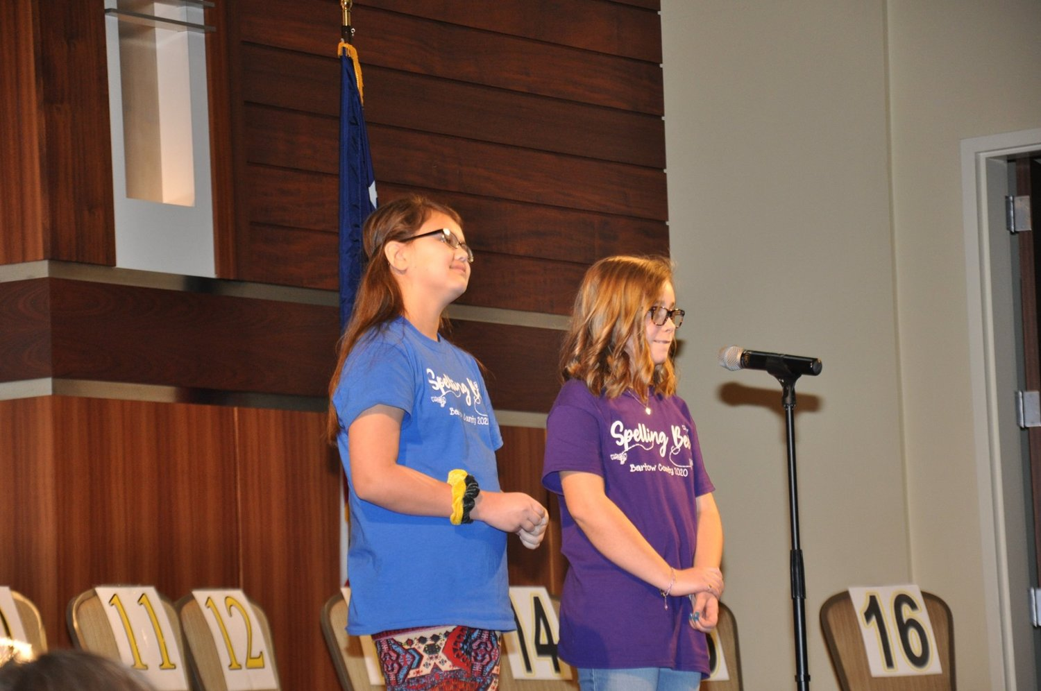 Fifth-graders Leilah Bedford, left, from Kingston Elementary and Mary Harris Gambill from Mission Road Elementary compete for the title of Bartow County spelling champion.