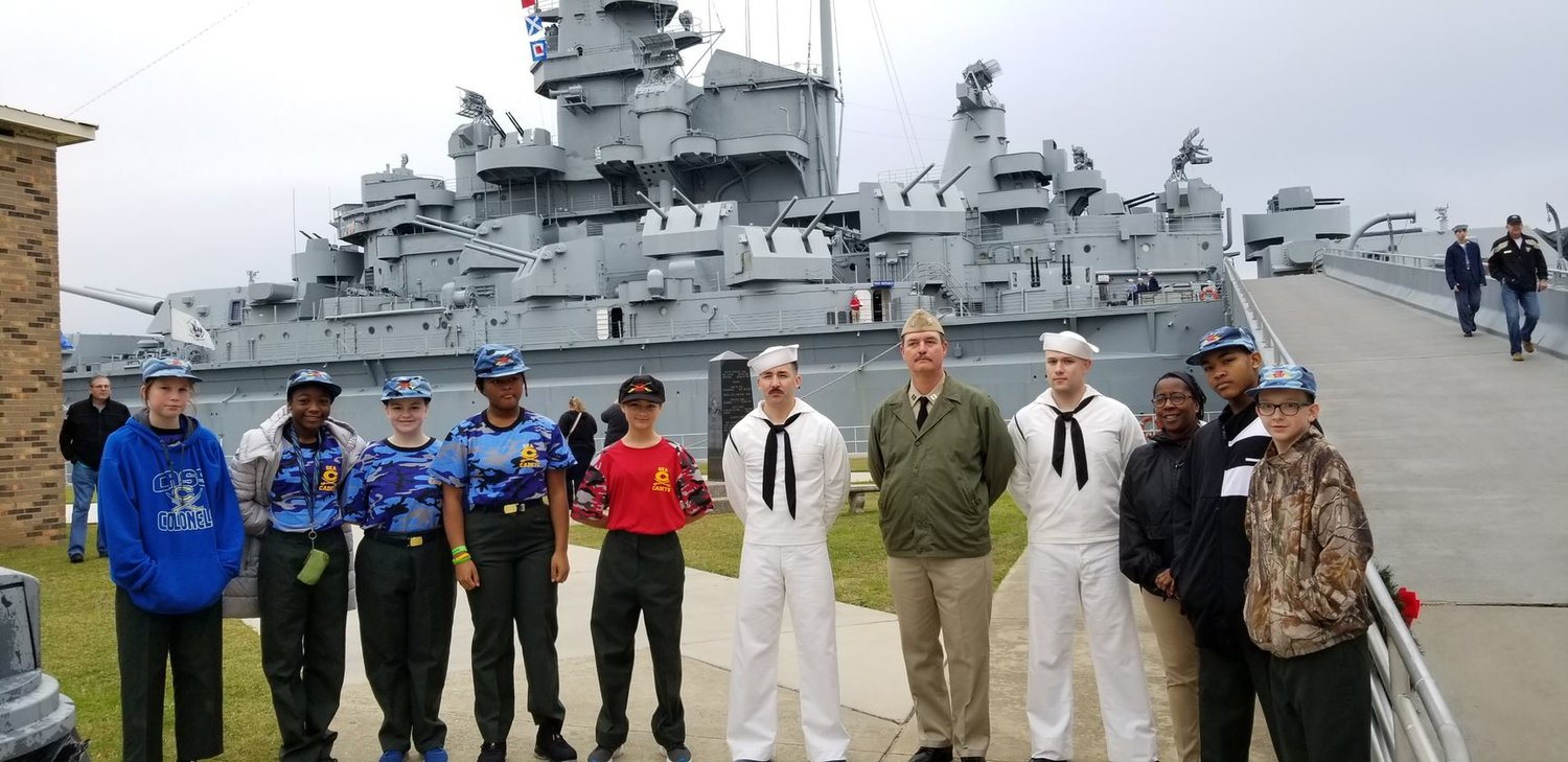 Cass Middle JROTC sea cadets and their chaperone/teacher Rasha Williams visited with three sailors from the Pearl Harbor re-enactment crew before boarding the USS Alabama. From left were eighth-grader Haley Jefferson, seventh-graders Chloe Aaron and Hollie McCarver, eighth-graders Janiyah Pollard and Kelly Sisk, the sailors, Williams and seventh-graders Gary Alston and Dalton Aaron.
