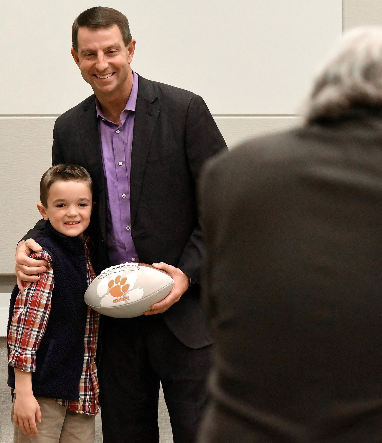 Football fans of all ages waited patiently in line for a picture with Clemson head football coach Dabo Swinney Thursday night at the Clarence Brown Conference Center in Cartersville. Swinney spoke to a standing-room-only crowd during the 15th Annual Bartow County FCA Home Team Fundraising Banquet.