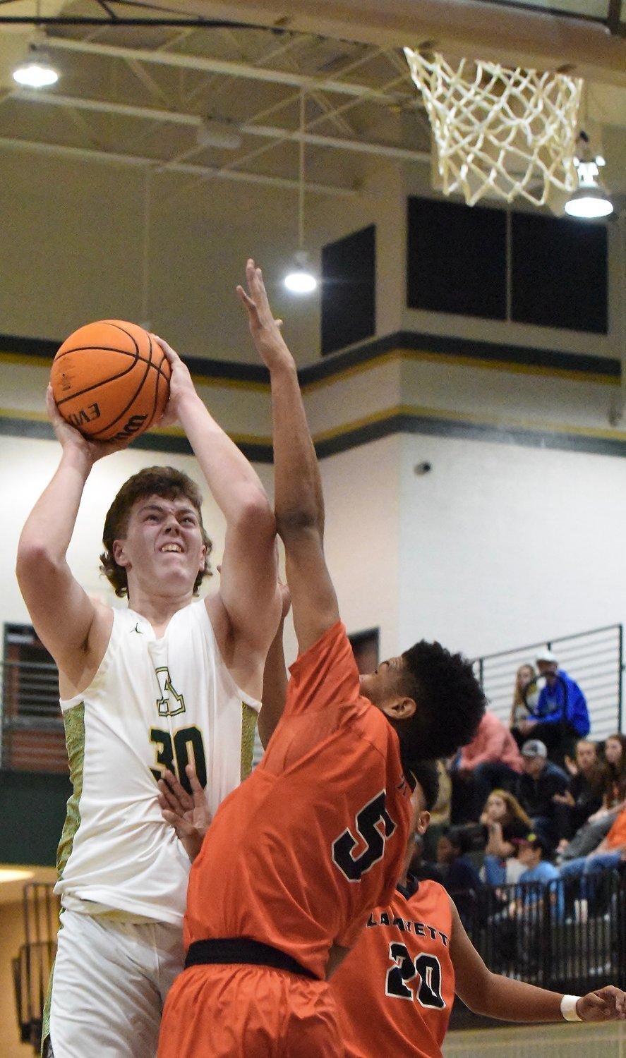 Adairsville senior Jaxon Welchel goes up for a shot against LaFayette in the semifinals of the AHS Tiger Christmas Clash Dec. 28, 2019, in Adairsville.