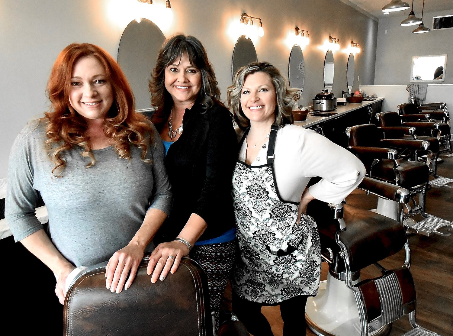 After being closed for nearly six weeks due to the coronavirus, Cartersville Barber Shop owner Jonette Roberson, left, was able to reopen her newly remodeled shop for business on May 5. Roberson and her two barbers, Verna White, center, and Angela Rhoden, have seen a steady stream of clients since reopening. The shop is in the Cartersville Plaza at 234 N. Dixie Ave.