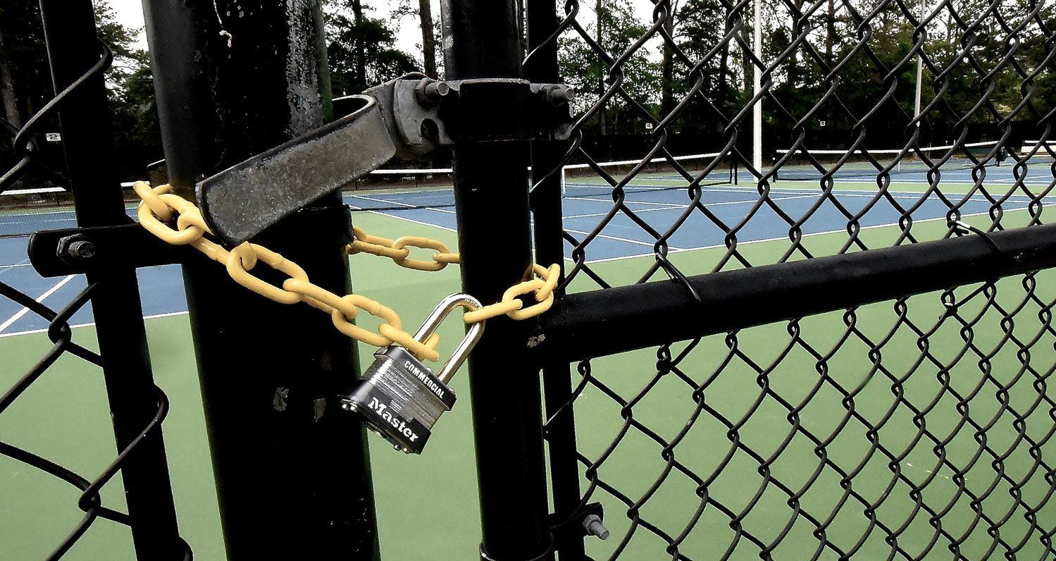 Dellinger Park in Cartersville opened to the public this week, but there are still locks on the tennis and basketball courts.