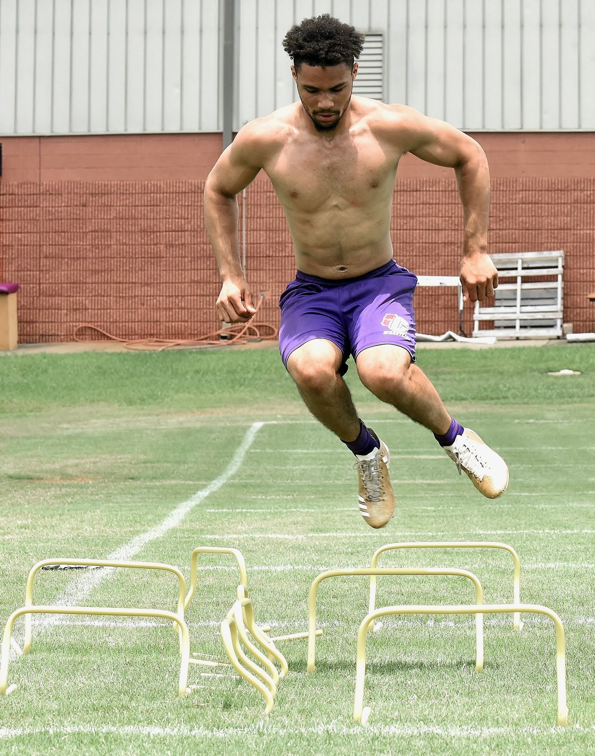 Cartersville rising senior Rashar Locklear goes through a drill during a workout Tuesday at the Canes practice field.