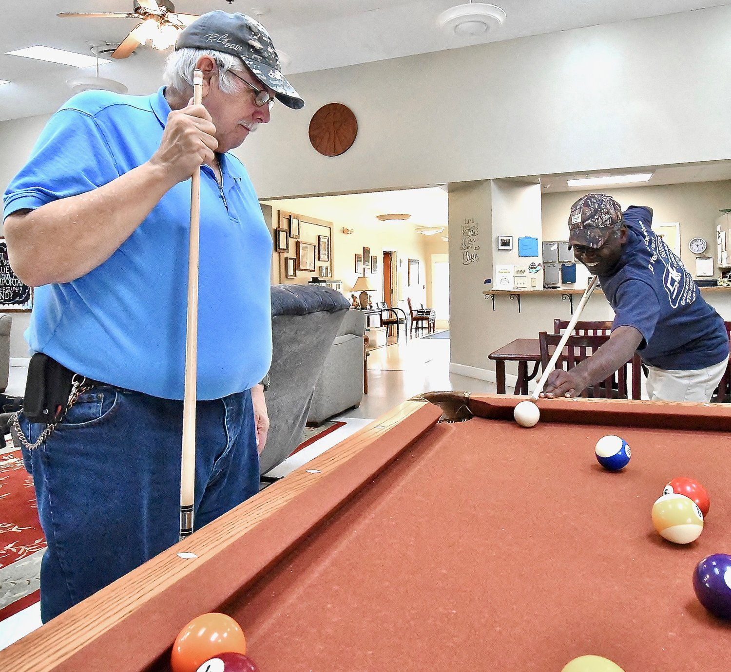 Hickory Log residents Charlie Morehead, right, and Sammy Harbin enjoy a game of pool in the facility's recreation room.