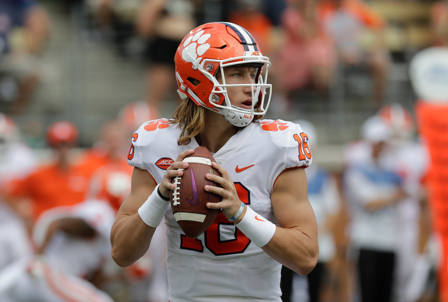 In this Oct 6, 2018, file photo, Clemson's Trevor Lawrence looks to pass against Wake Forest during the first half of a game in Charlotte, North Carolina.