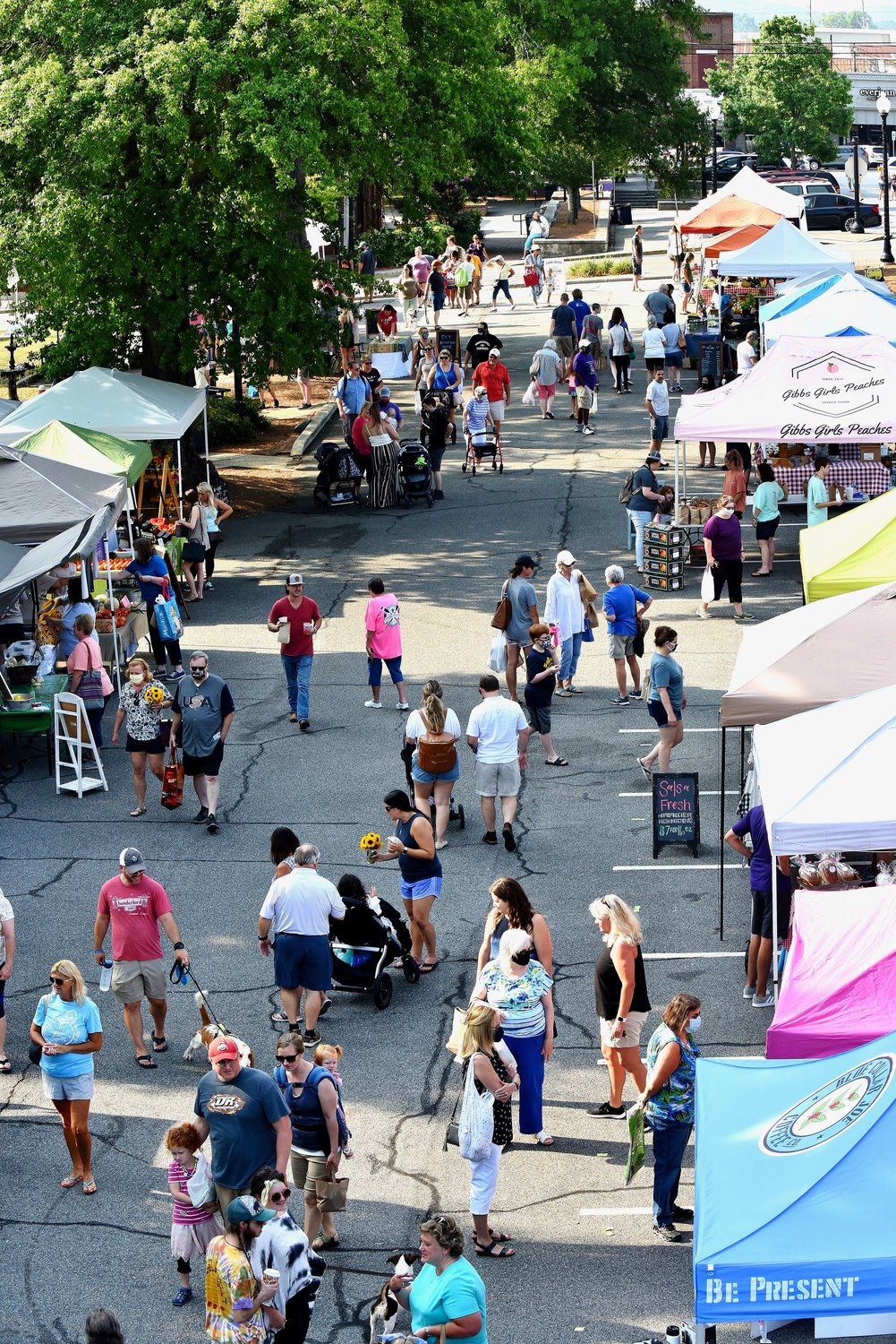 As seen from the Church Street bridge, the Cartersville Farmers Market attracts shoppers of all ages. The downtown market is open from 8 a.m. until noon every Saturday morning through Sept. 26.