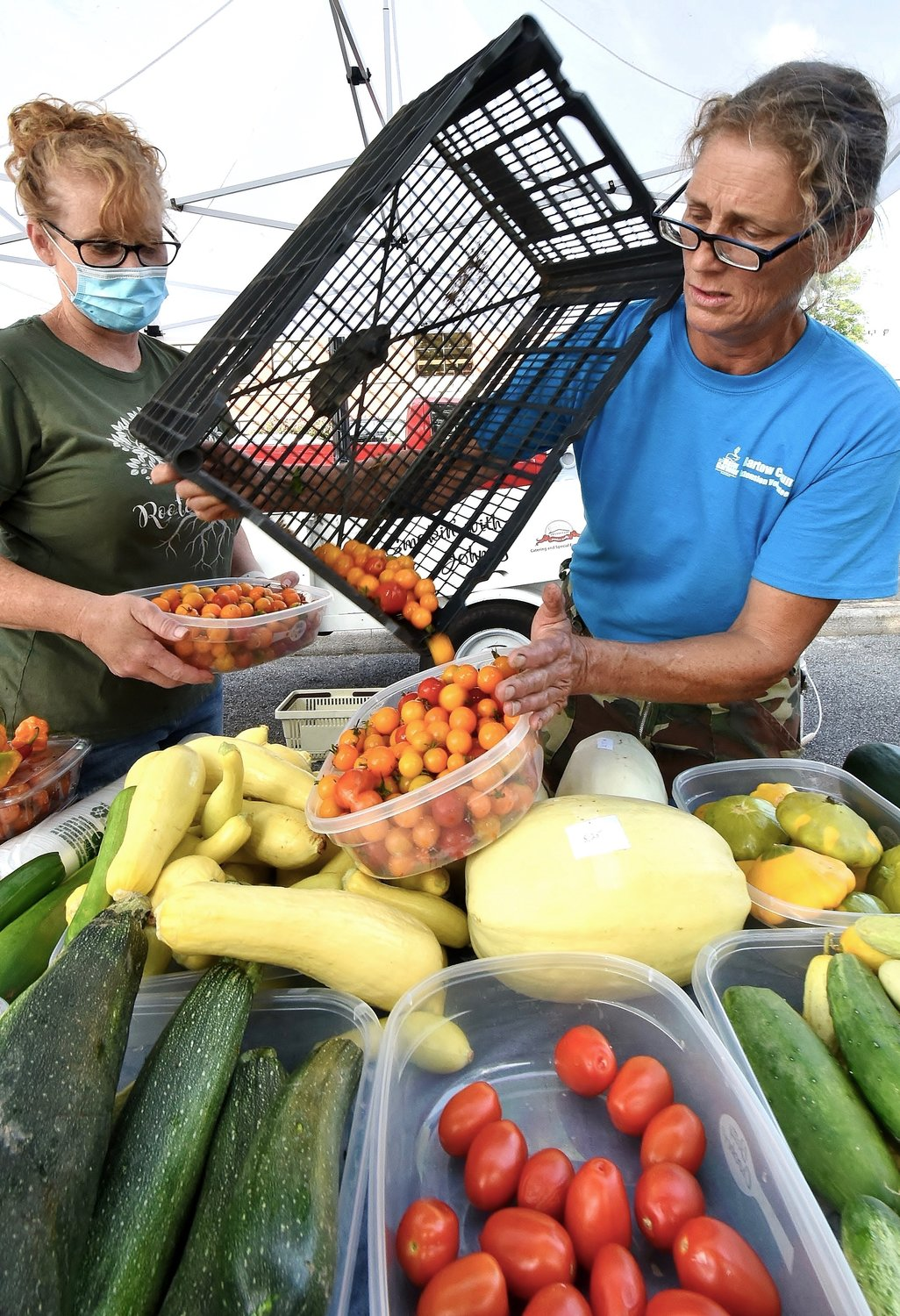 Samijo Miron, right, and Shana Smith, of Southern Sown, offer many different fresh vegetables at the Cartersville Farmers Market.