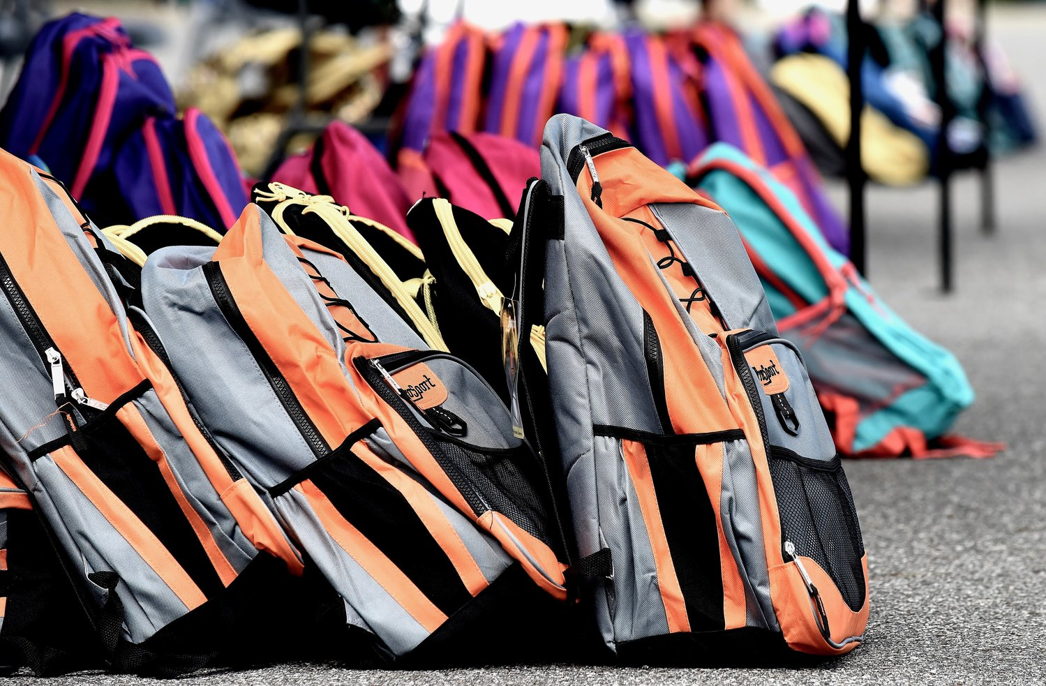Backpacks of a variety colors and styles were filled with school supplies and distributed to students during Bartow Give a Kid a Chance.