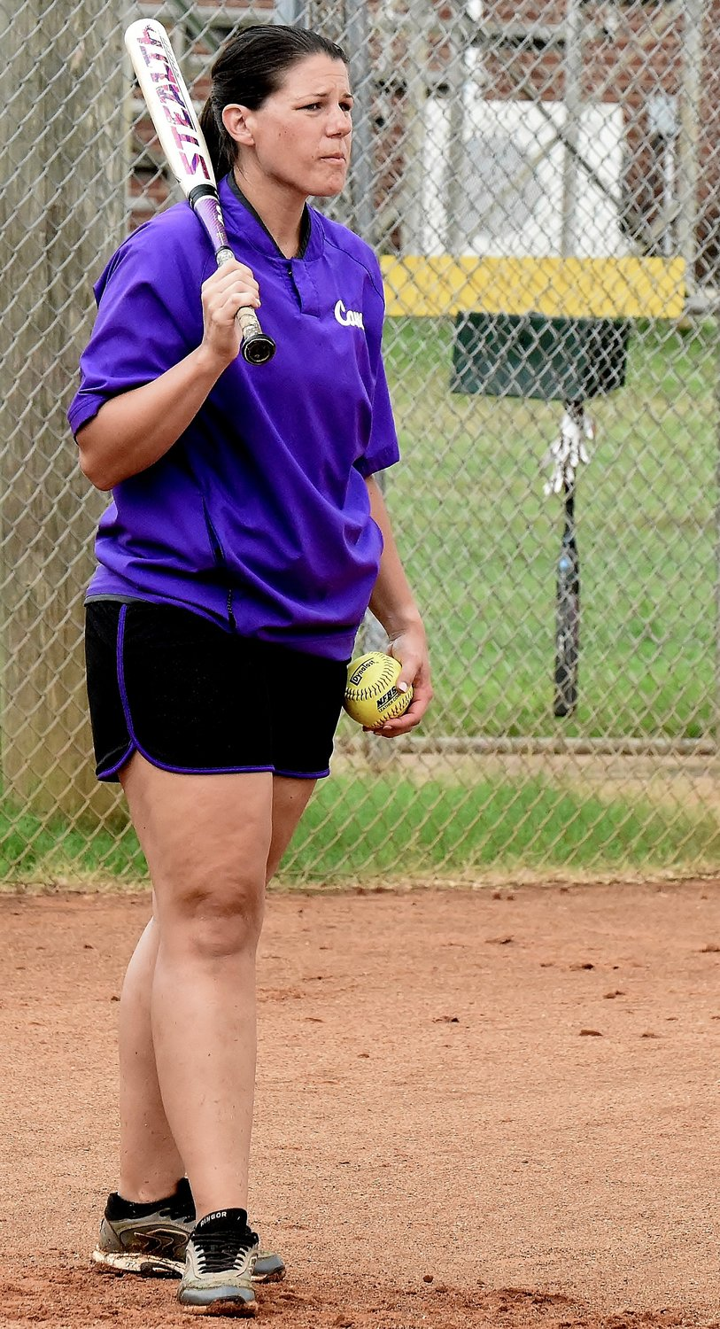 Cartersville High head softball coach Shannon Suarez prepares to hit the ball during a defensive drill as part of a workout Thursday.