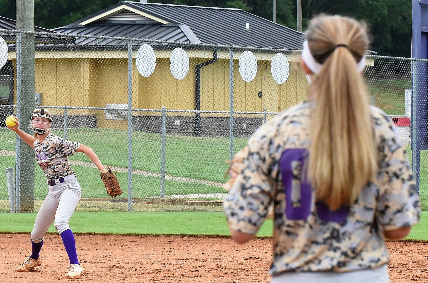 Cartersville High rising sophomore Kiley Arnold, left, prepares to throw across the diamond to classmate Campbell Rogers during a workout Thursday.