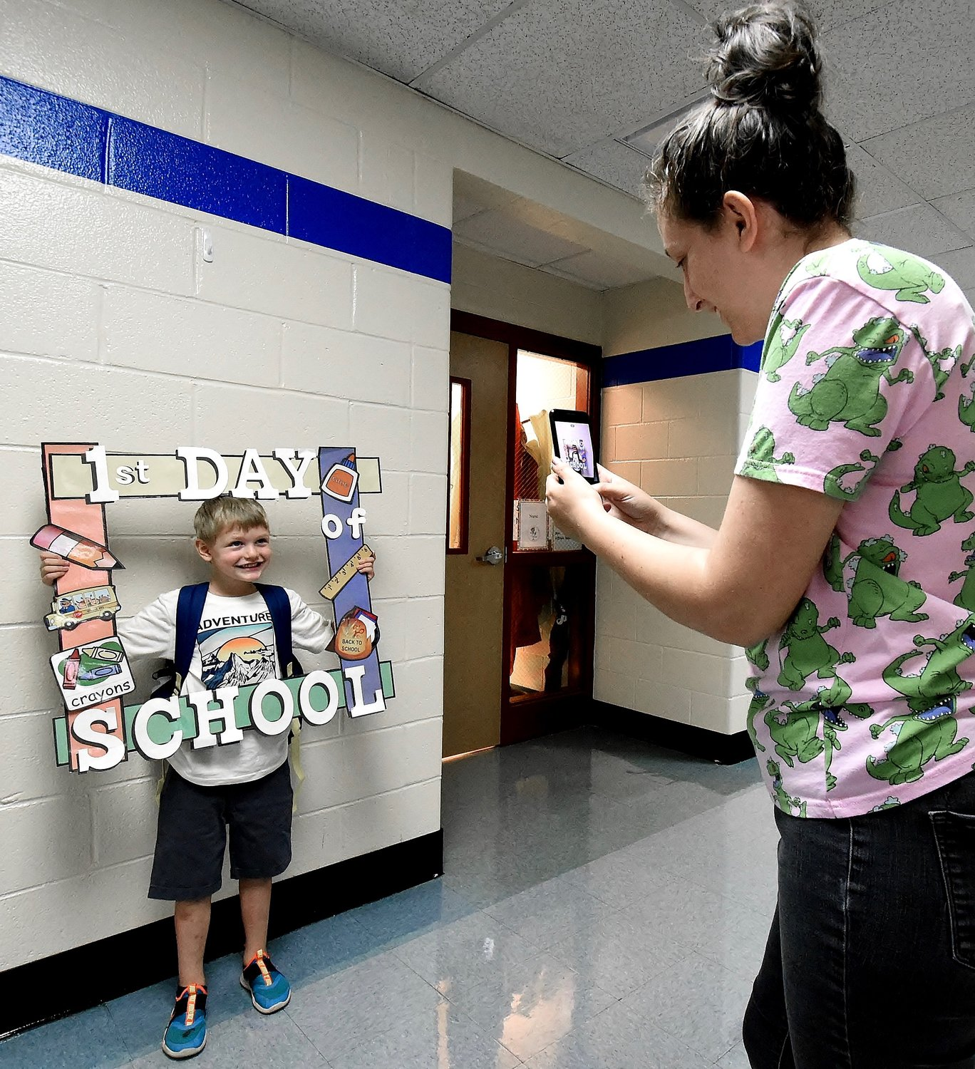 RANDY PARKER/THE DAILY TRIBUNE NEWS Hamilton Crossing Elementary student Abraham Young poses for a picture on his first day of school Wednesday.