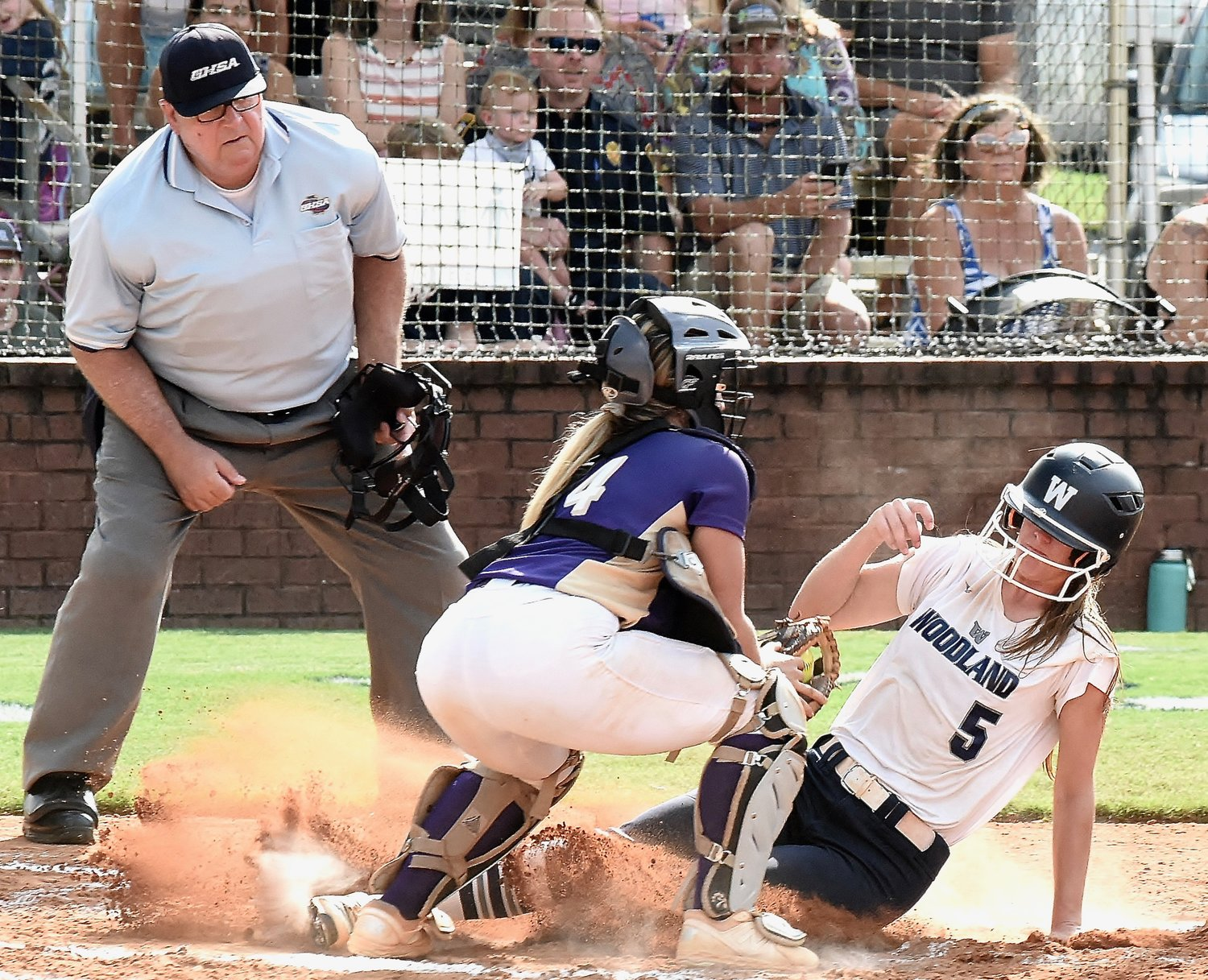 Woodland senior Morgan Cooper scores ahead of a tag from Cartersville senior Maggie Pruitt during Game 1 of Tuesday's doubleheader. Cooper went 3-for-5 with a home run, two walks, two RBIs and three runs scored.