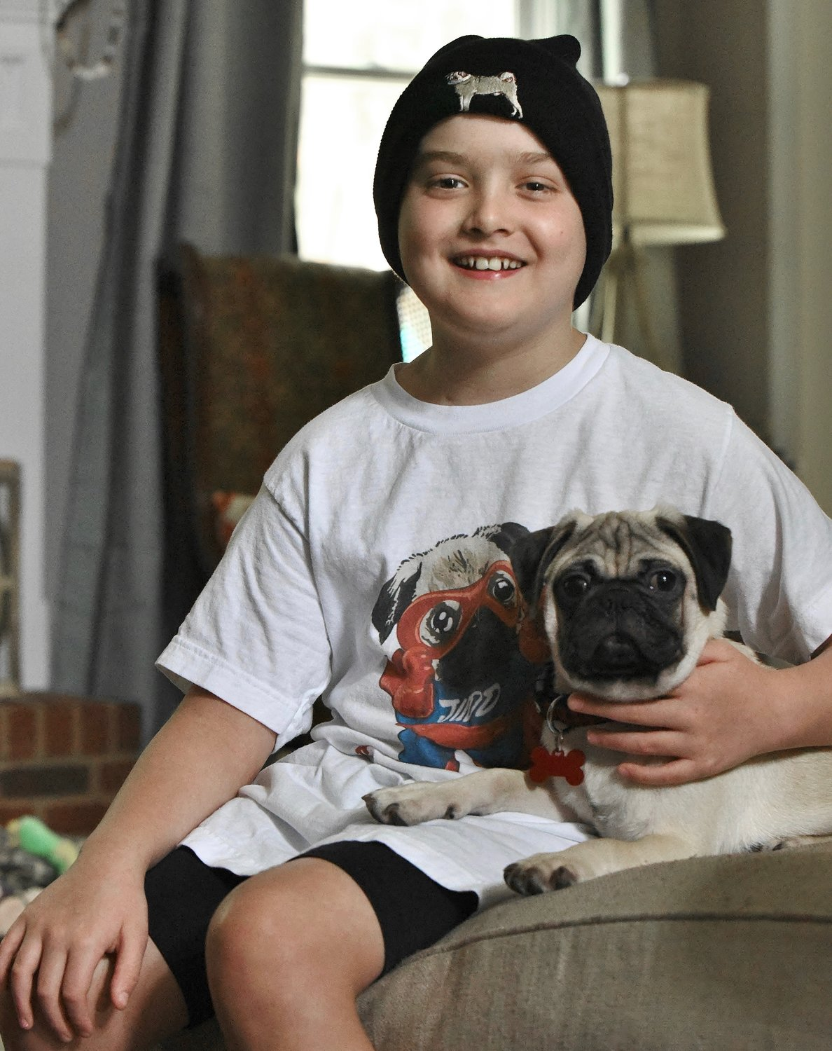 Mission Road Elementary School third-grader Judd Bailey, who is battling stage 2 B-cell lymphoblastic lymphoma, received a pug puppy, Rocco, from Petland Kennesaw last week.