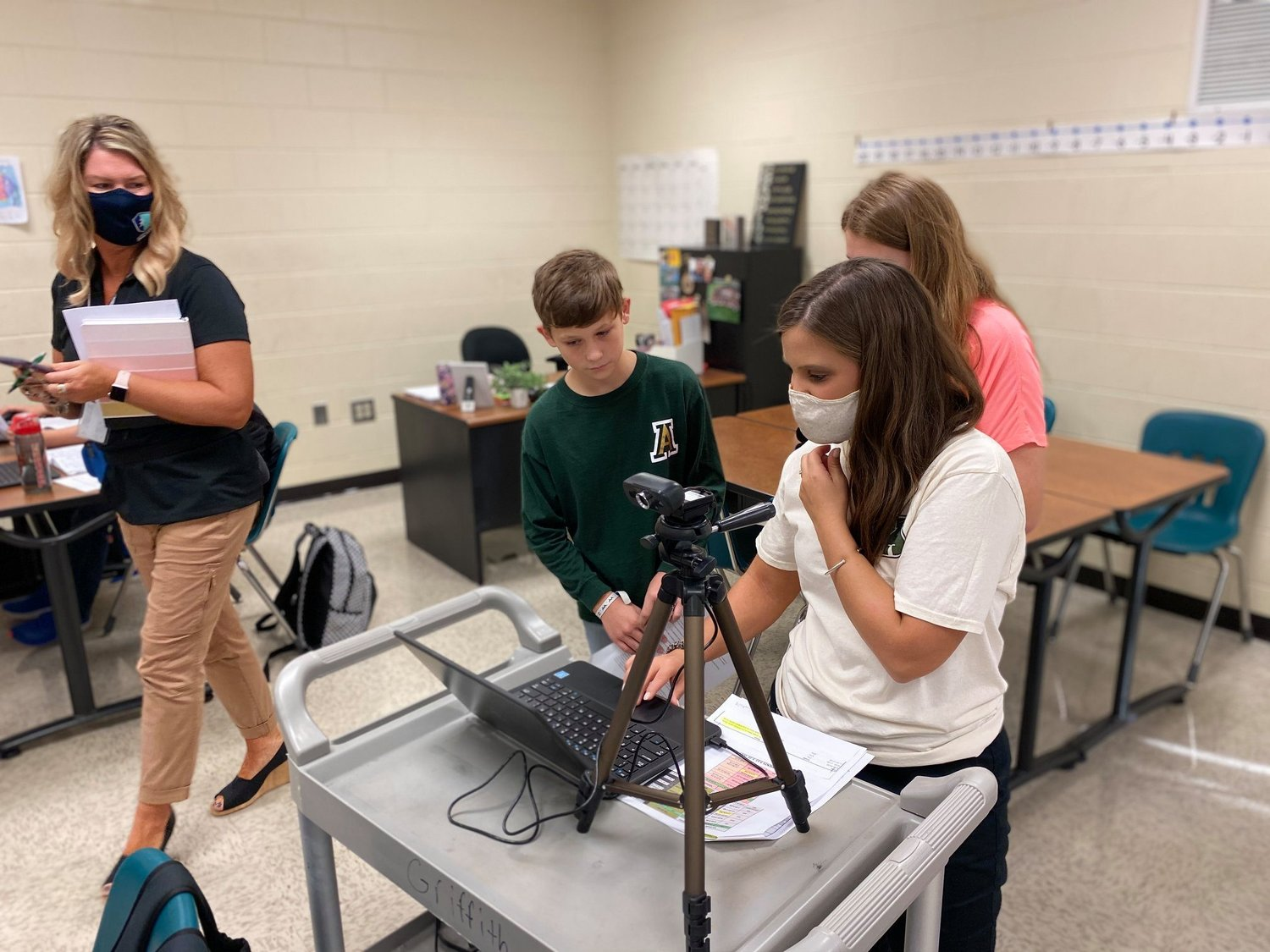 From left, Paula Camp, director of advanced learning and academic support programs for Bartow County Schools; Adairsville Middle seventh-grader Brandon Spurgeon; seventh-grade math teacher Katherine Tatum; and seventh-grader Ashlyn Gillespie participate in a virtual STEM walk with Georgia Department of Education representatives last month.