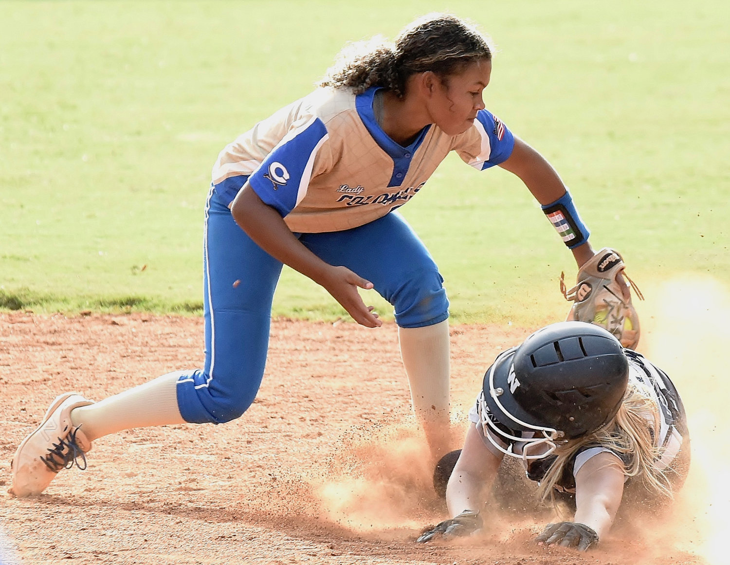 Cass sophomore Alexis Woods tags a Woodland runner out at second base during a game earlier this season.