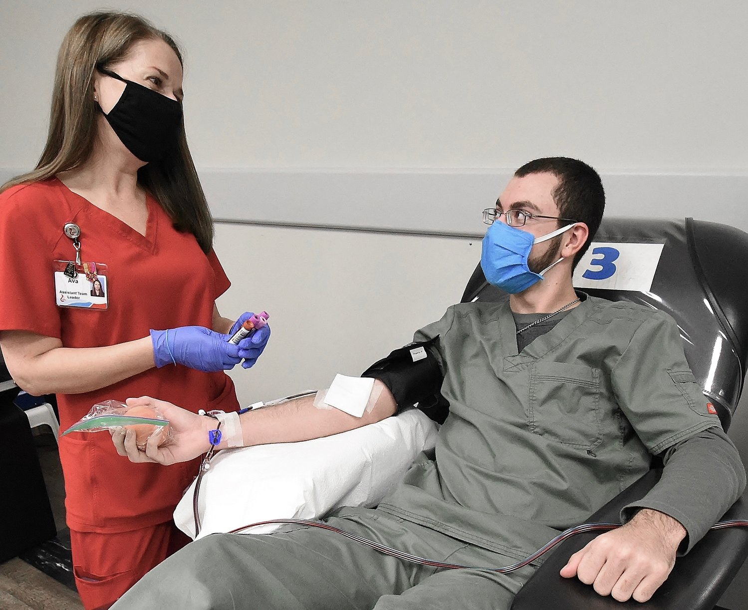 Blood Assurance Assistant Team Leader Ava Voyles talks with donor Hunter Calvert at the Cartersville Donation Center.